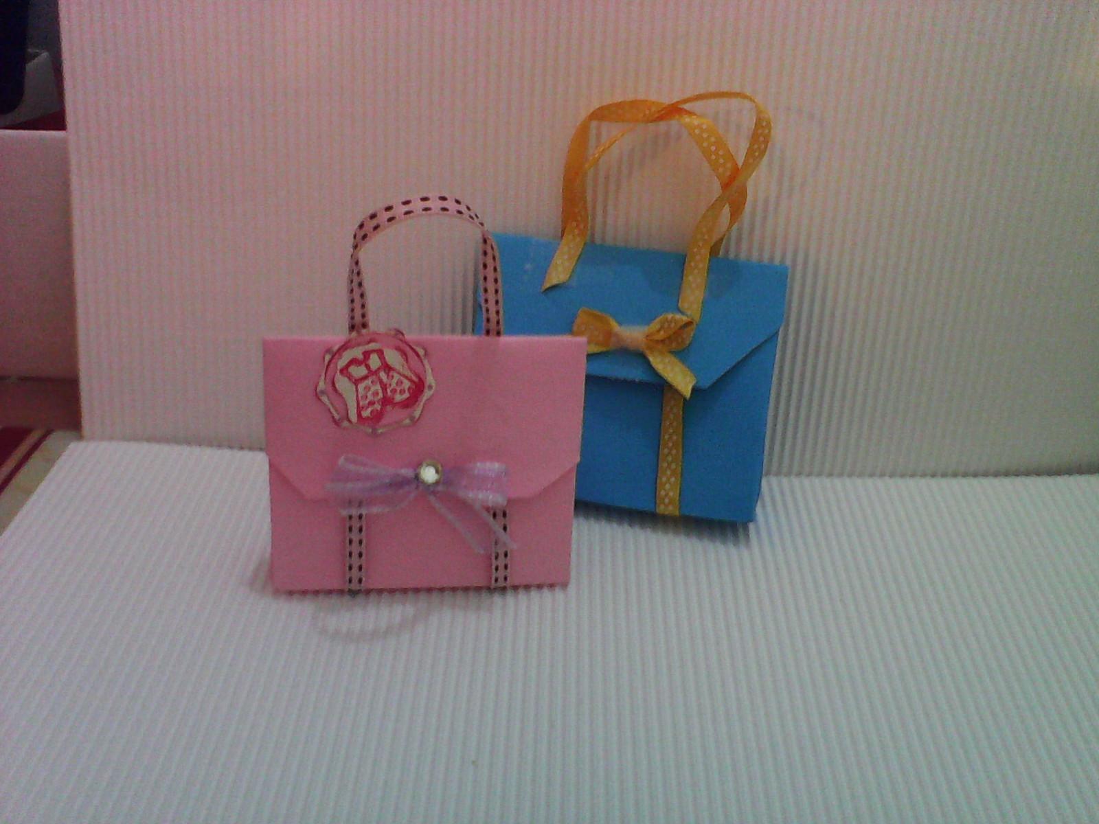 Set da 10..Graziose bomboniere borsetta oppure origami.